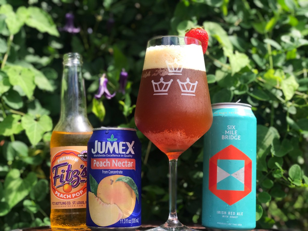 """We took the """"Beermosa"""" concept and got creative with this """"Beerllini,"""" a take on the classic Bellini which is usually made with Prosecco and Peach Nectar. We made this sweet and delicious brunch concoction with 2 parts SMB Irish Red Ale, 1 part peach soda, and a heavy splash of peach nectar. Delicious!"""